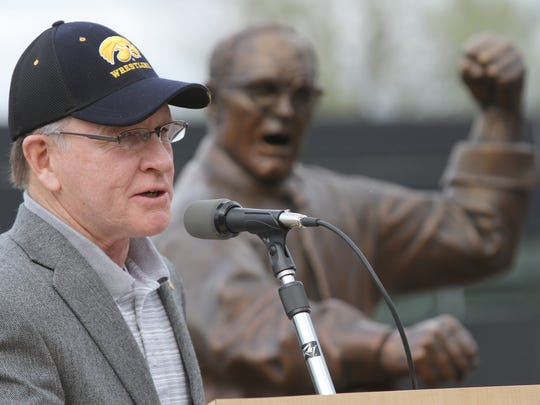 Dan Gable speaks during his statue unveiling at Carver-Hawkeye Arena in 2012.