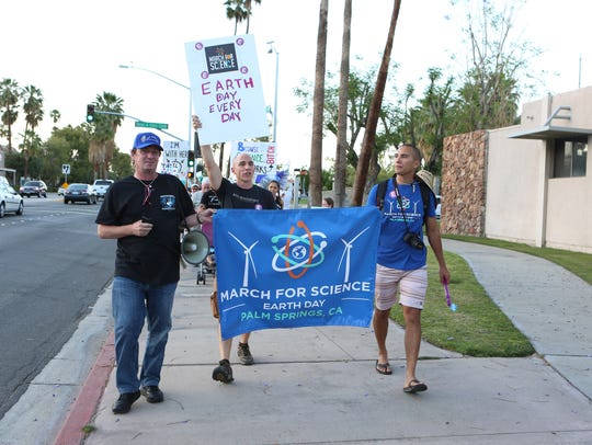 Environmental activists participate in the March for