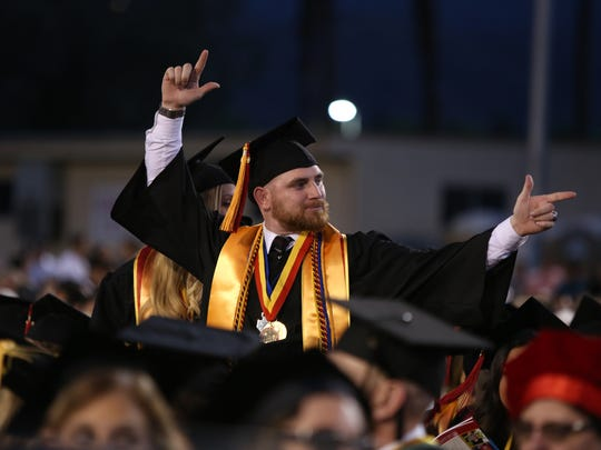 Nicholas Meade stands to be recognized during the College of the Desert commencement ceremony in Palm Desert on Friday, May 26, 2017.