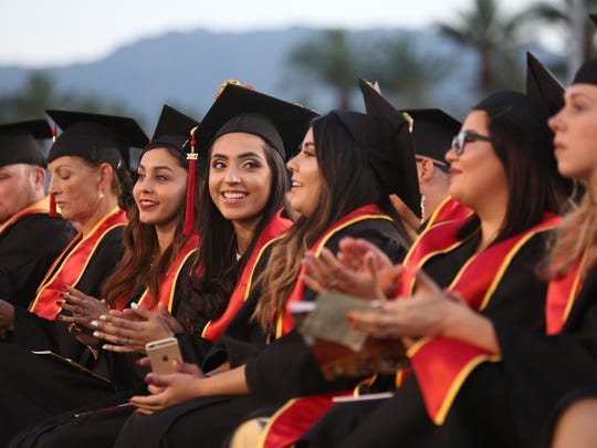 College of the Desert graduates listen to the speakers during the commencement ceremony in Palm Desert on Friday, May 26, 2017.