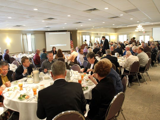 In this file photo from 2012, guests enjoy lunch during