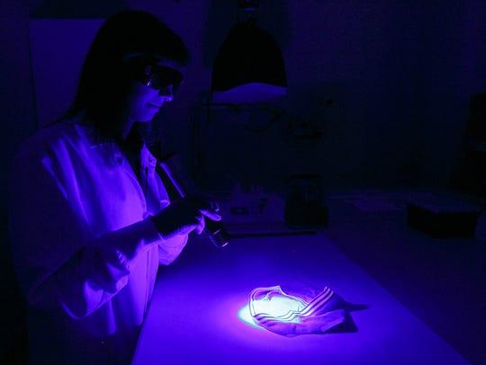 Forensic scientist Jennifer Buttler uses an alternate