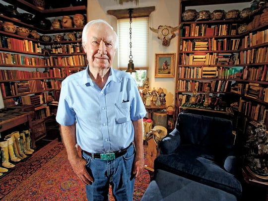 In this July 4, 2014 photo, Forrest Fenn poses at his Santa Fe, N.M., home. New Mexico's top law enforcement officer is asking Fenn, the author and antiquities dealer who inspired thousands to comb remote corners of the West in vain for a chest of gold and jewels to end the treasure hunt. The plea from New Mexico State Police Chief Pete Kassetas follows what authorities believe is the latest death related to the hunt for Fenn's hidden treasure.