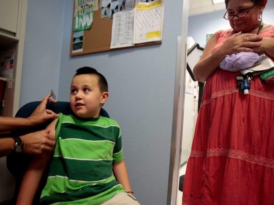Xavier Cartas, 5, aniticipates his immunization shots
