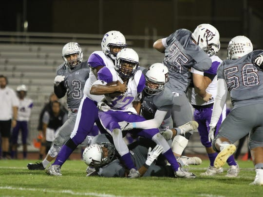 Jurupa Hills' William Brock is tackled by Rancho Mirage