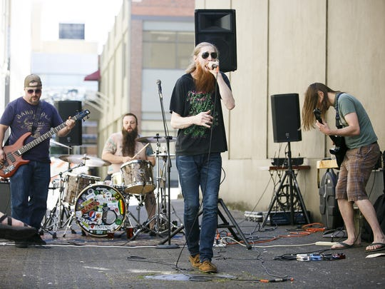 Salem-based hard rock band Felony Flats performs behind Taproot for Make Music Day in Downtown Salem on Wednesday, June 21, 2017. Make Music Day is a global celebration of making music that takes place every year on June 21.