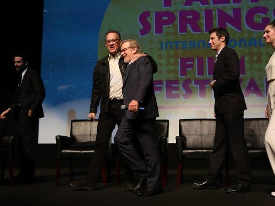 Actor Tom Hanks grabs director Steven Spielberg while