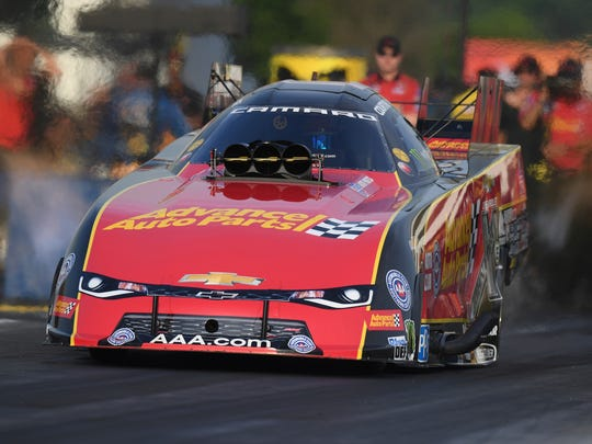 In this photo provided by the NHRA, Courtney Force drives in Funny Car qualifying at the Virginia NHRA Nationals drag races at Virginia Motorsports Park in Dinwiddie, Va., Friday, June 8, 2018. Force took the provisional top spot with a run of 3.983 seconds at 323.35 mph. (Jerry Foss/NHRA via AP)