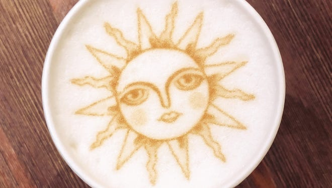 An image of the sun was printed on top of a lavender latte at Mug & Spoon in Rehoboth Beach.