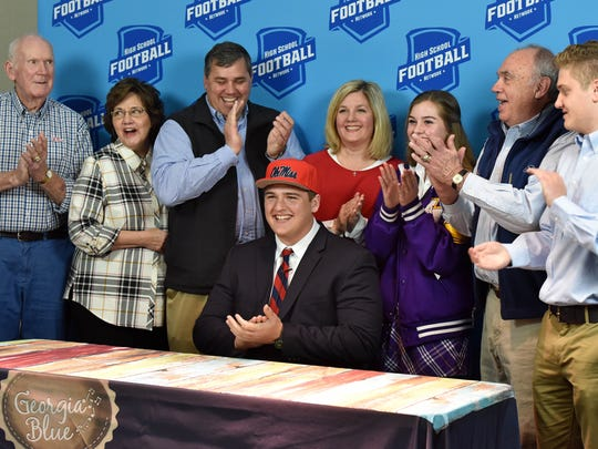 Ben Brown, center, makes his announcement to play college football at Ole Miss on National Signing Day.