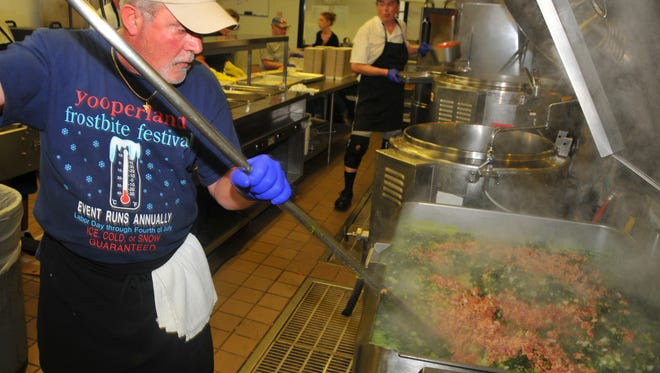 """Chef John Pollei mixes bacon into the turnip greens at the Meals on Wheels kitchen in Cocoa. Brevard County will phase out giving grants to local nonprofits in its community-based organization program over the next five years. Under the current """"community-based organization"""" grant program, the county gives $510,200 which helps pay for a total of 15 programs provided by 12 nonprofit organizations in the current budget year. Aging Matters in Brevard received $60,000 for the Meals on Wheels senior nutrition program and $32,200 for other senior assistance programs."""