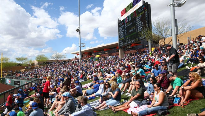 Recond crowd of 14,002 watched the Chicago Cubs play the Arizona Diamondbacks during spring training action on Mar. 23, 2017 at Salt River Fields in Scottsdale, Ariz.