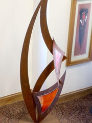 A sculpture with Tiffany-style glass inlays by Joe Gutmann is on display at Two Brothers Wines.