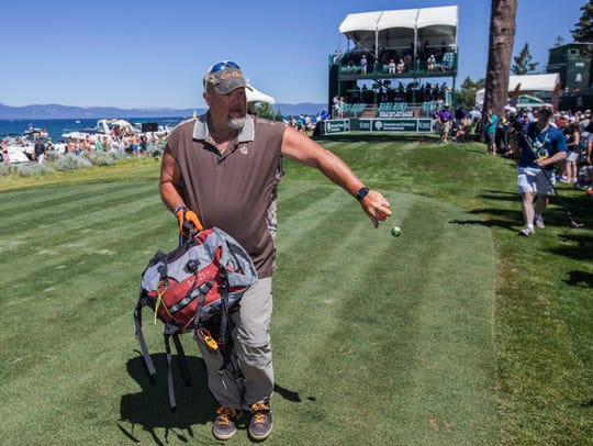 Larry The Cable Guy tosses golf balls to fans during