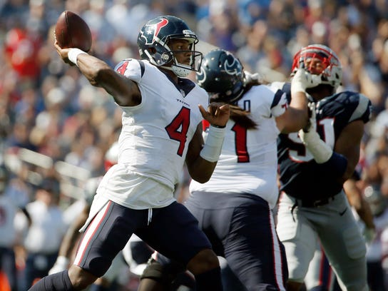 Houston Texans quarterback Deshaun Watson (4) passes against the New England Patriots during the first half of an NFL football game, Sunday, Sept. 24, 2017, in Foxborough, Mass. (AP Photo/Michael Dwyer)