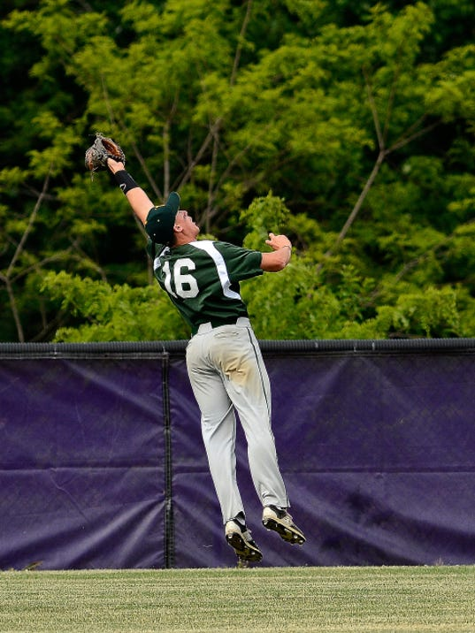 York Catholic center fielder C.J. Burnside makes a leaping catch on an Upper Dauphin fly ball during a District 3-AA baseball semifinal game on Tuesday. York Catholic lost the game, 12-5.