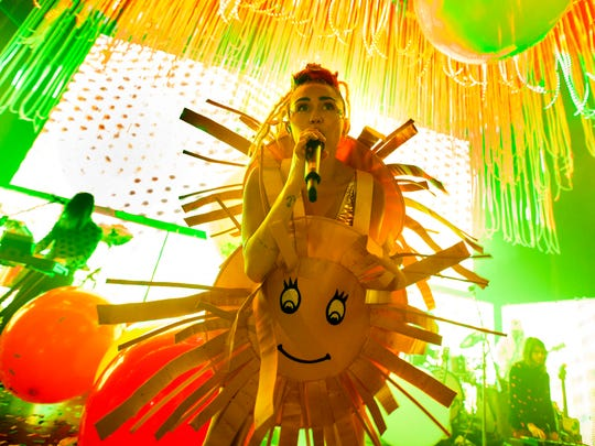 A smiley sun is one of many vibrant costumes Cyrus