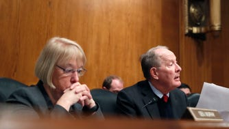 In this Jan. 31, 2017, file photo, Senate Health, Education, Labor and Pensions Chairman Lamar Alexander, R-Tenn., accompanied by ranking member Patty Murray, D-Wash., speaks during a hearing on Capitol Hill.
