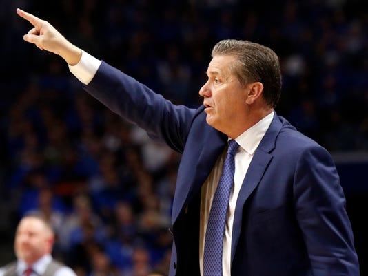 Kentucky head coach John Calipari directs his team during the second half of an NCAA college basketball game against Virginia Tech, Saturday, Dec. 16, 2017, in Lexington, Ky. (AP Photo/James Crisp)