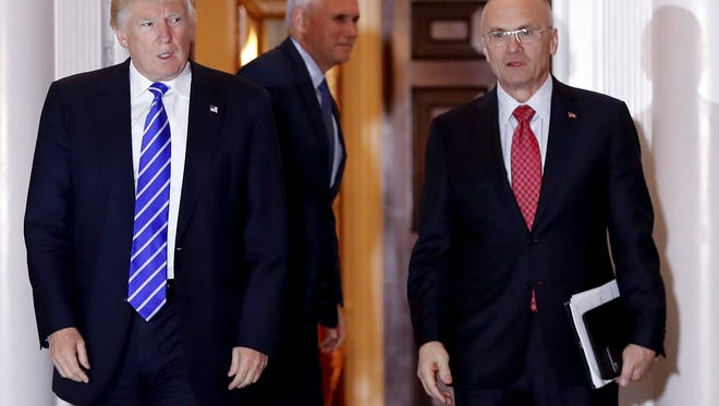 Then-President-elect Donald Trump with then-Labor Secretary-designate Andrew Puzder. With Puzder out of the picture, fast-food's hopes for representation in Trump's Cabinet have been at least temporarily dashed, a major setback for an industry that has felt under siege in recent years.