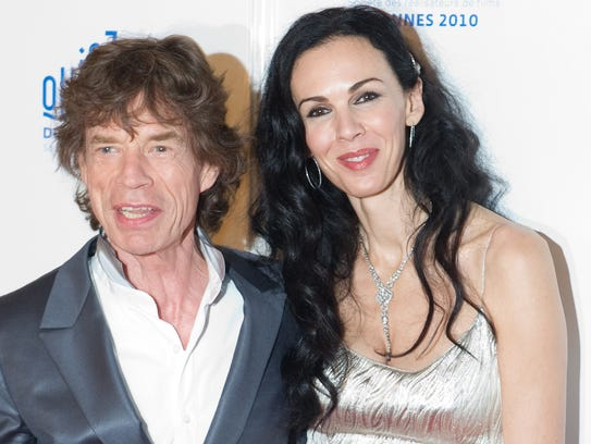 "(FILES) In this photo taken on May 19, 2010 British singer of ""The Rolling Stones"", Mick Jagger and US stylist L'Wren Scott arrive for the screening of ""Stones in Exil"" presented as a special screening at the Quinzaine des Realisateurs during the 63rd Cannes Film Festival  in Cannes. L'Wren Scott, American fashion designer to the stars and long-time girlfriend of Rolling Stones frontman Mick Jagger, was found dead at her New York apartment on March 17, 2014. AFP PHOTO / MARTIN BUREAUMARTIN BUREAU/AFP/Getty Images"