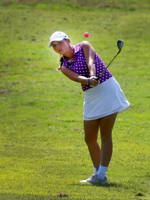 Milan's Karlie Alexander hits her ball to the green to the 18th green during the final round of the TSSAA Division I small division girls' golf championship, on Wednesday, Sept. 27, 2017, at WillowBrook Golf Club in Manchester.