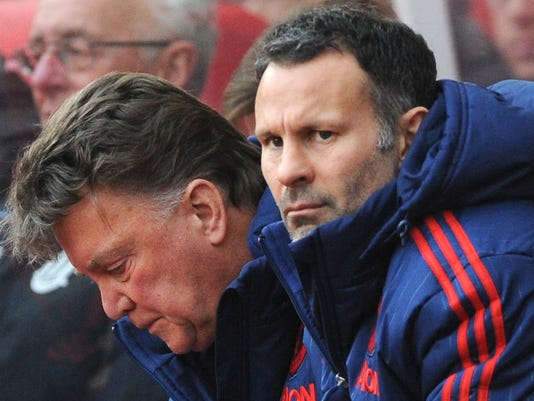 Manchester United manager Louis van Gaal, left, and assistant manager Ryan Giggs watches the English Premier League soccer match between Stoke City and Manchester United at the Britannia Stadium, Stoke on Trent, England, Saturday, Dec. 26, 2015. (AP Photo/Rui Vieira)