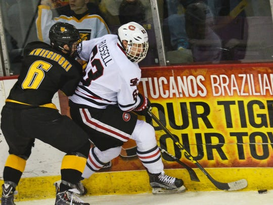 St. Cloud State's Patrick Russell battles along the