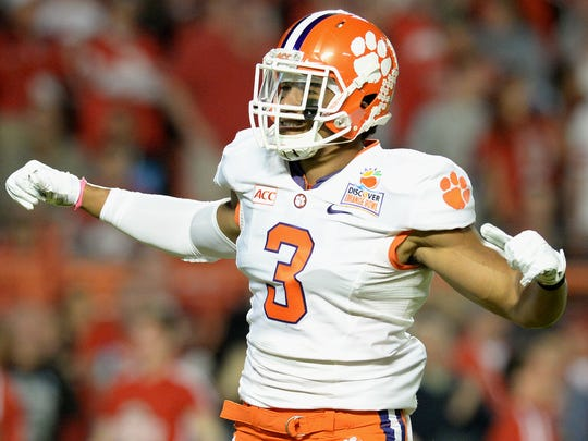 Clemson defensive end Vic Beasley (3) reacts after