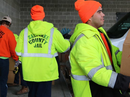 Inmates at the Salt Lake County Jail load sagebrush