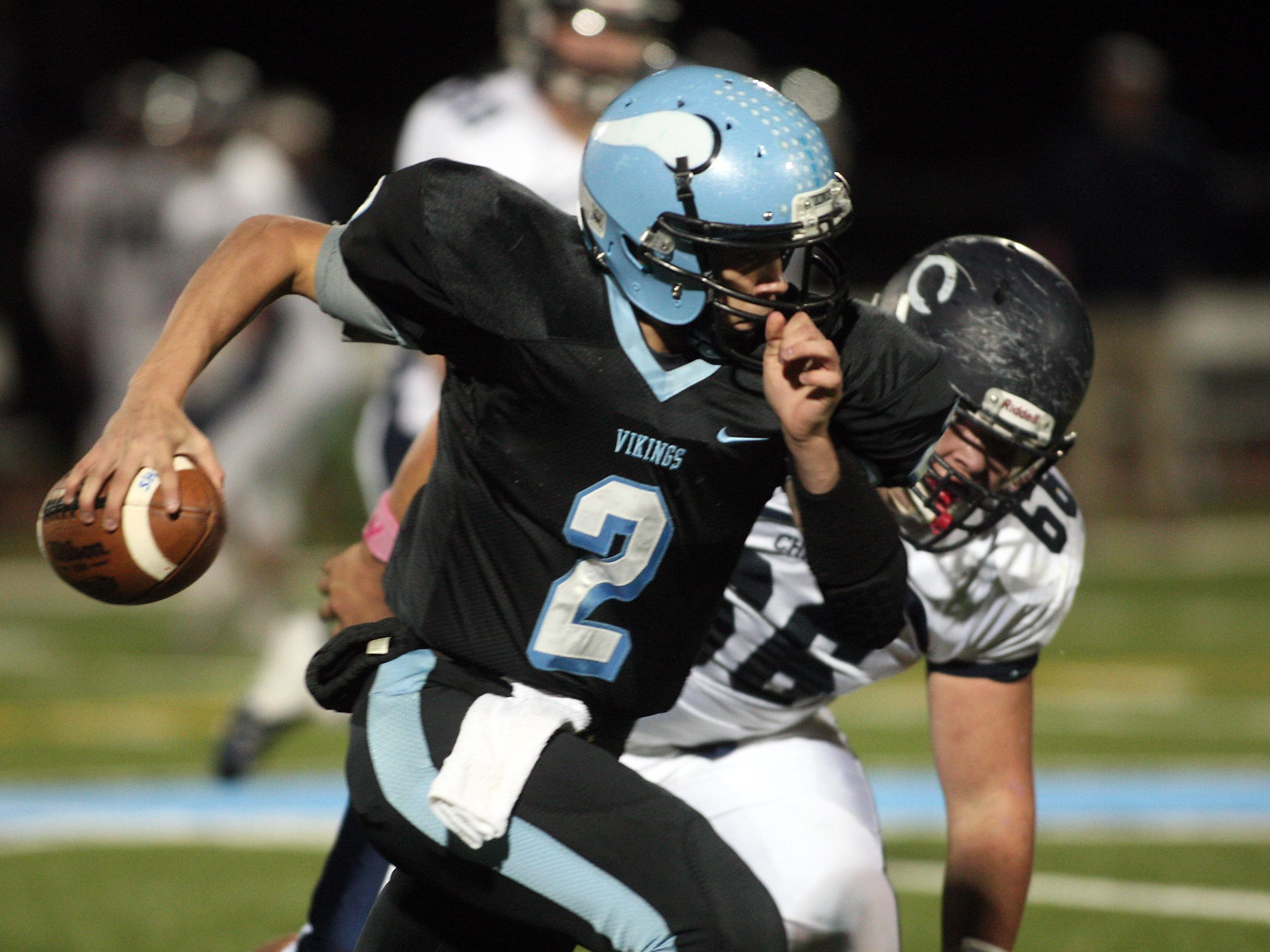 Parsippany Hills quarterback Nick Verducci runs to the end zone on a 57 yard keeper vs. Chatham in a showdown with playoff implications. October 30, 2015, Parsippany, NJ.