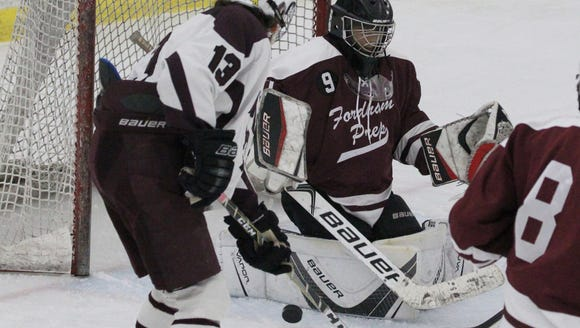Scarsdale's Mike Shur picks up a rebound and scores
