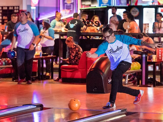 Alex Lopez bowls with coworkers at the newly refurbished