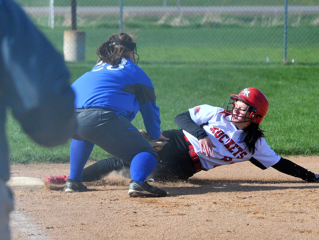 Spencer's Mandie Schultz, right, slides safely into third base during the first inning as Athens' Alexa Gajewski covers the bag during Tuesday nonconference softball game at Athens High School