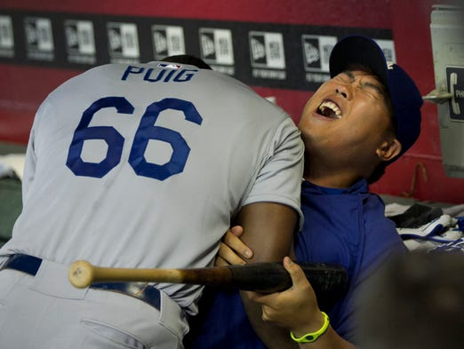 Dodgers' Yasiel Puig jokes around with teammate Hyun-Jin Ryu before a game against the Diamondbacks at Chase Field in Phoenix, AZ, on Sunday, April 13, 2014.