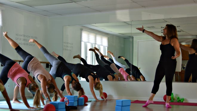 Julie Wender leads a Barre fitness class at her studio, Shore Barre, in Bethany Beach.