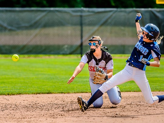 Claire McInerney,left, of Escanaba tosses the ball to 2nd base to force out Carley Barjaktarovich of Richmond during their Division 2 state semifinal game Thursday June 15, 2017 at Seccia Stadium in East Lansing.  KEVIN W. FOWLER PHOTO