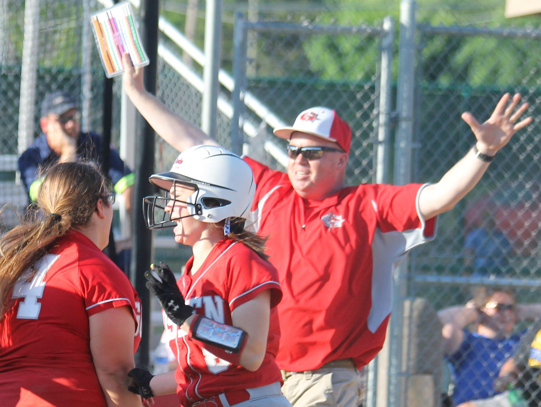 Goshen coach Eric Campbell celebrates with his team after its first sectional championship in program history.
