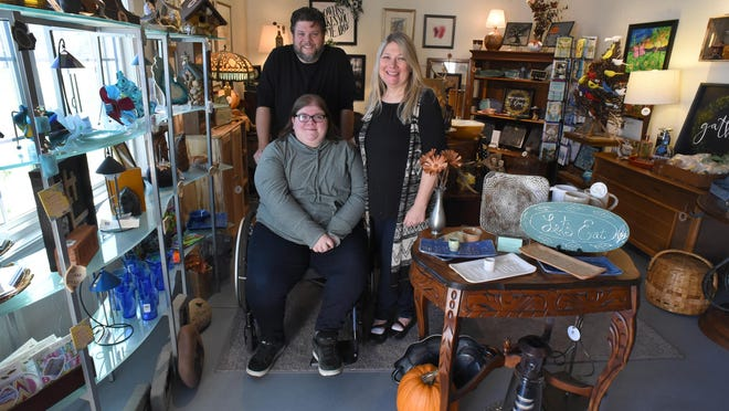 """Jocelyne Fisher (center), along with her parents Mike and Lynette Fisher, have opened """"Gathered Creations: Something Old, Something New, Something Created Just For You"""" in Temperance."""