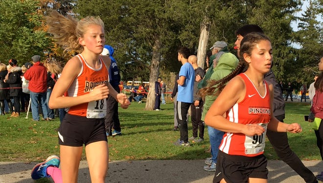 Brighton's Lindsey Witte (left) and Pinckney's Mia Garcia (right) made an impact as freshmen on state-qualifying cross country teams last fall.