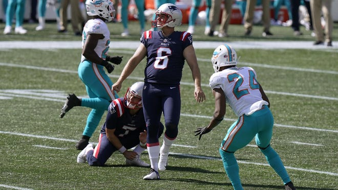 New England Patriots kicker Nick Folk (6) follows through on an extra point in the second half of an NFL football game against the Miami Dolphins, Sunday, Sept. 13, 2020, in Foxborough, Mass.