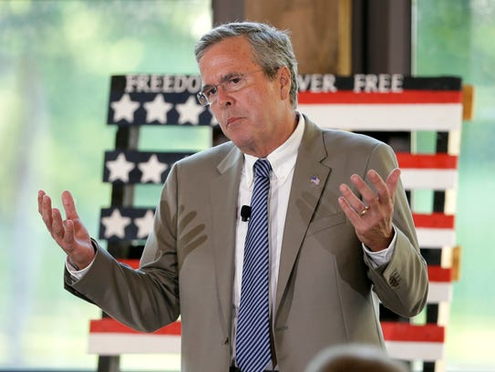 Jeb Bush speaks to local residents during the Judge