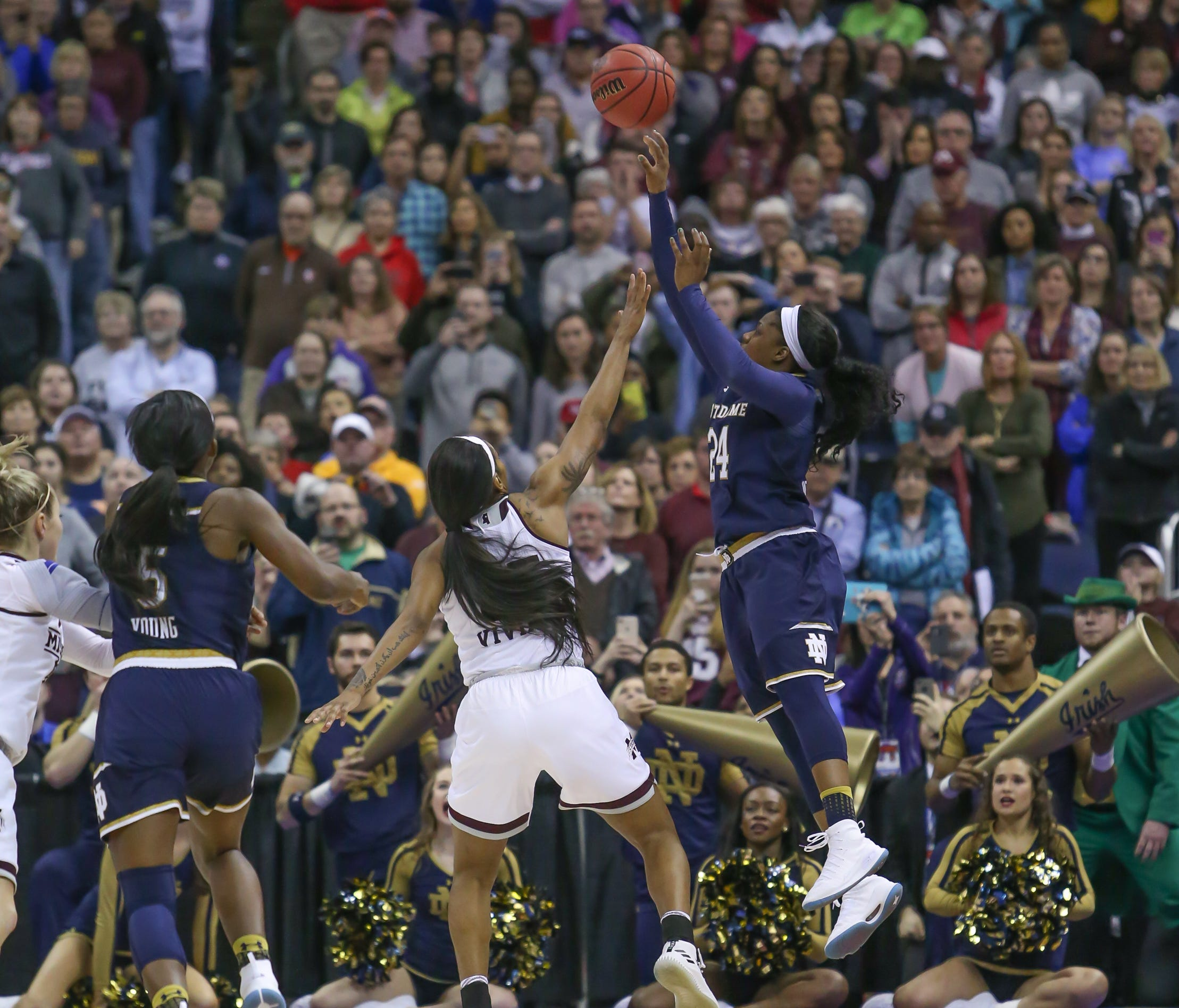 Notre Dame's Arike Ogunbowale (24) puts up a last-second shot to win the game for the Fighting Irish. Mississippi State played Notre Dame  in the NCAA Women's Basketball Championship in Columbus, Ohio, on Sunday, April 1, 2018.