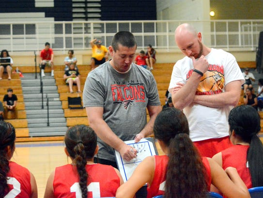 Loving coach Jason Parrish draws up plays during the