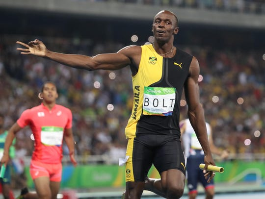 Usain Bolt (JAM) reacts after the men''s 4x100 relay
