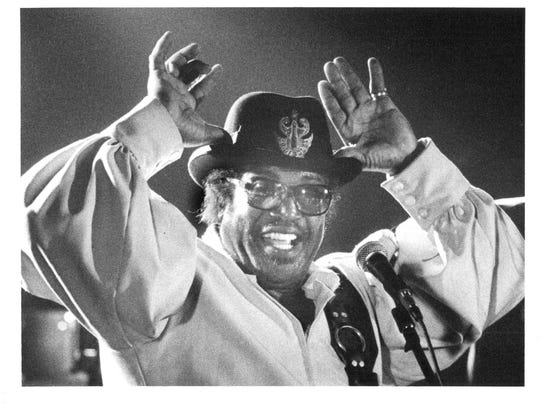 Bo Diddley performed at Idols in January 1988. He's pictured showing an audience his moose antlers.