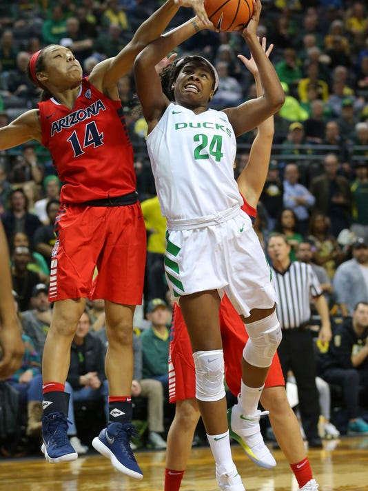 Oregon's Ruthy Hebard scores as she is fouled by Arizona forward Sam Thomas during an NCAA college basketball game in Eugene, Ore., Friday, Jan. 12, 2018. (Brian Davies/The Register-Guard via AP)