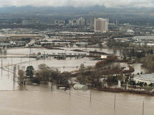 A 55-acre parcel sought by Washoe County for flood control improvements is inundated by floodwaters along with surrounding land during the January 1997 flood. The parcel can be seen below and to the left of the Hilton and above tand to the left of the bright roof in the center right of the photo.