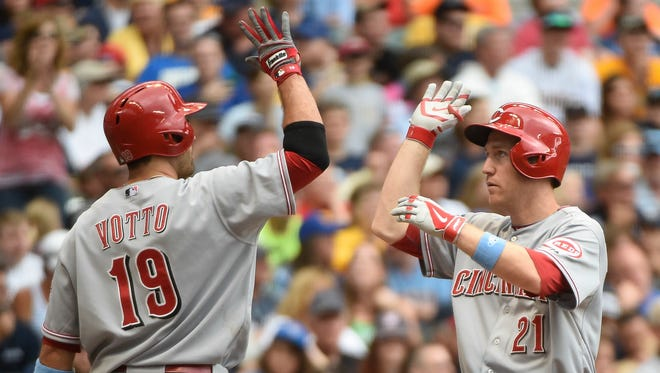 Cincinnati Reds third baseman Todd Frazier (21) is greeted by first baseman Joey Votto (19) after hitting a two-run homer in the fifth inning against the Milwaukee Brewers at Miller Park.