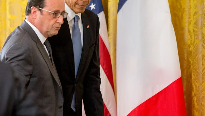 President Barack Obama and President Francois Hollande of France depart following a joint news conference in the East Room at the White House in Washington, Tuesday, Nov. 24, 2015.
